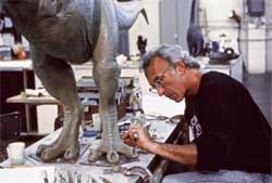 "In this undated image released by Stan Winston Studio, Stan Winston is shown working on a dinosaur for the film, ""Jurassic Park"". Winston, the Oscar-winning special-effects maestro responsible for bringing the dinosaurs of ""Jurassic Park"" and other iconic movie creatures to life, has died. He was 62. He died at his home in Malibu surrounded by family on Sunday, June 15, 2008, after a seven-year struggle with multiple myeloma, according to a representative from Stan Winston Studio."